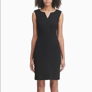 Seamed career sheath dress in black